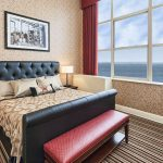 Lakeside Executive King | Our lakeside Executive room has one King size, Serta presidential suite pillow top bed, a separate living room area that has a queen size sofa sleeper, a jetted tub in the bathroom, and large section windows that overlook Lake Superior.